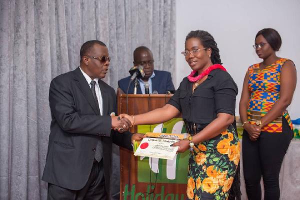 Madam Afua Asabea Asare receiving the award