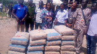 Lawyer Charity Akua Oforiwaa Dwommoh (3rd Left), presenting the building materials