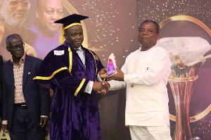 Frank Adjei receiving his award