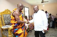 Nana Addo Dankwa Akufo-Addo and Oseadeayo Kwesi Kennin IV in a handshake