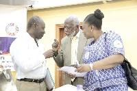 Prof. Stephen Adei (middle), Chairman, NDPC, interacting with Mr Ken Ofori-Atta(L)
