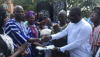Alhaji Iddrisu presenting the cash to Mohammed Alhassan Ghana, Northern Regional NPP Youth Organizer
