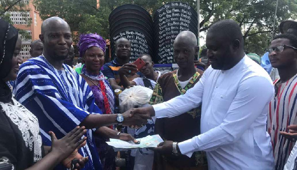 Alhaji Iddrisu presenting the cash to Mohammed Alhassan Ghana, Northern Regional NPP Youth Organizer