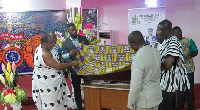 Very Rev. Felix Tawiah Danquah assisted by other members of the church to unveil the project