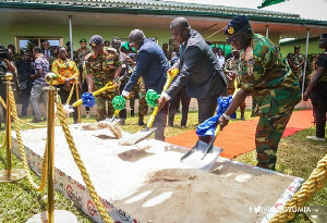 Dr Mahamudu Bawumia together with 2 others cutting sod for new Ghana Army Headquarters