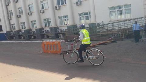 Ras Mubarak, MP for Kumbugu riding his bike to parliament