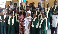 Esi, flanked by members of St Lawrence Catholic Church at Abura