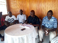 Macfamous Kudoloh flanked by some executives addressing the press