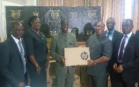 Prof Joseph Ghartey Ampiah (3rd from left) receives the donation from Dr Dzani (3rd from right)