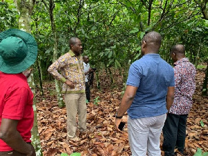 Cocobod CEO Joseph Boahen Aidoo with his officials on a tour