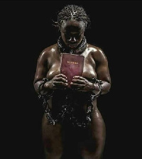 Naked woman holding a Bible