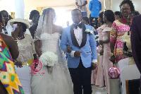 Michael Asumadu Adomako and his bride Dorcas Maame Asamoah walking down the aisle.