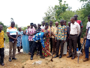 Simon Kweku Tetteh cutting sod for the construction of Wawase healthcare