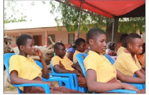 Junior High School pupils seated at an event