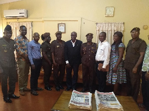 DDP Mr Tannor (m) flanked by other officers and representatives of HOPE Project and TOLEC GH