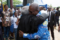 Mahama hugs his critic Martey