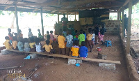 Kwabena Dwomo Krom pupils sitting on the bare floor in class