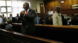 Firebrand politician Julius Malema acknowledges supporters in court