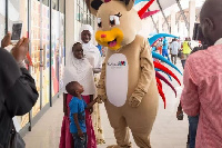 The KCM Mascot, 'Kotoko', goes smooth with a young visitor