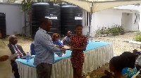 Larry Addo making a presentation to one of this year's beneficiaries