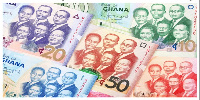 The cedi is currently trading at 5.32827 to a dollar