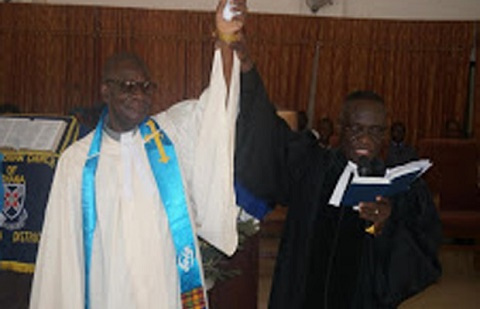 Rev. Roy Asiamah (left) being inducted by Rev. Michael G. Anim-Tettey