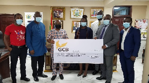 GCB officials (right) presenting a cheque to Volta Regional Minister