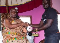 Asonaba presenting the CD to the chief