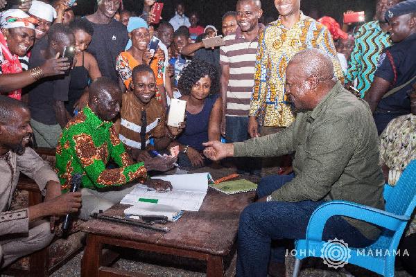 File photo: Former President John Mahama registers for the new NDC membership form