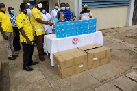 Dr. Joseph Tambil Medical Director of Effia-Nkwanta hospital received the items