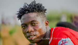 Asante Kotoko midfielder,Justice Blay