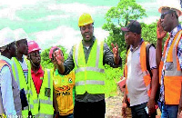 Sports Minister and team explaining a point to the contractor at the Ho centre