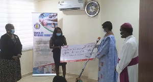 Ms Elizabeth Ayim presenting the dummy cheque to Justice Sophia Akufo