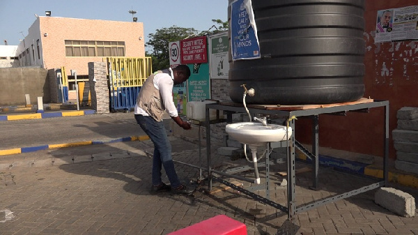 Leg-operated hand washer for use at Tema port