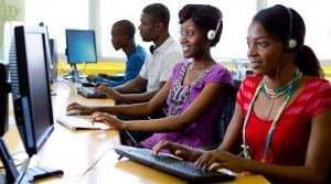 File photo of youth behind a computer