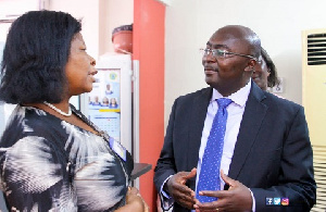 Vice president Dr. Mahamudu Bawumia in a chat with a staff