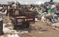 A tricycle at a dumpsite