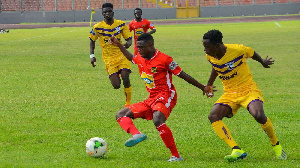 A file photo of Asante Kotoko winger Emmanuel Gyamfi against two players from Medeama S.C