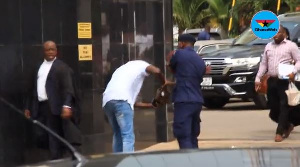 The police personnel slapped the civilian and retrieved a purse from him