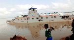 Kia truck loaded with yam falls off ferry into river