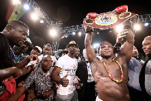 Isaac Dogboe displays his new title after winning the fight