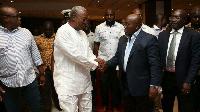 John Mahama (L) shakes Nana Akufo-Addo