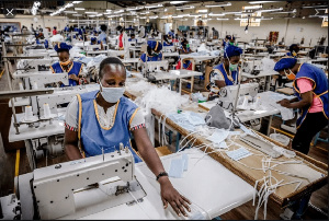 Workers in producing PPEs in a factory