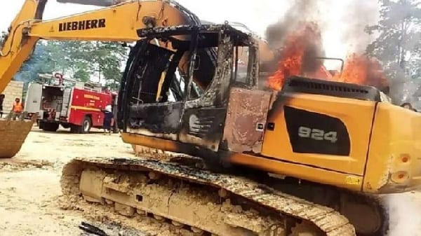 File photo of a burning excavator