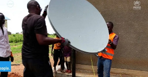 Avanti workers installing satellite dish