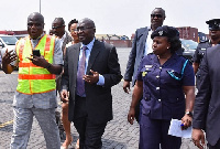 Mr Jacob Adorkor (in reflective jacket), the Director of Port, taking Dr Bawumia, the Vice-President