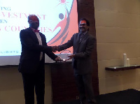 The First Sky Group Chairman receiving one of his two awards from Mr. Johnson.