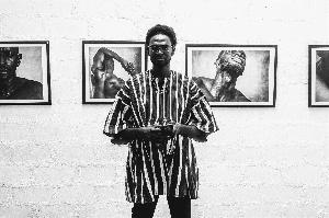 Ghanaian photographer, Kwasi Kyei Mensah recently organized an art exhibition at Osu