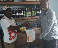 Charger Limited;producers of Happy Man Bitters with a representative from Kumasi Asante Kotoko