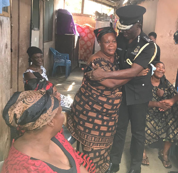 COP Dr. George Akuffo Dampare sympathize with the family at James Town in Accra